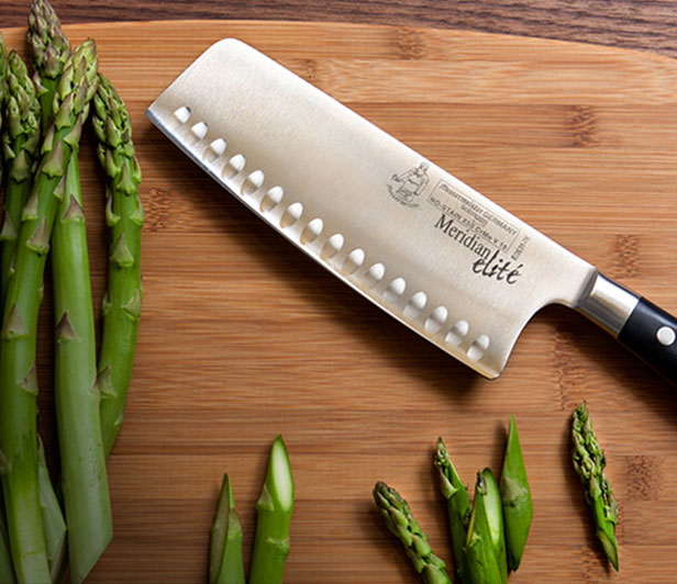 Messermeister Knife on a cutting board with Asparagus